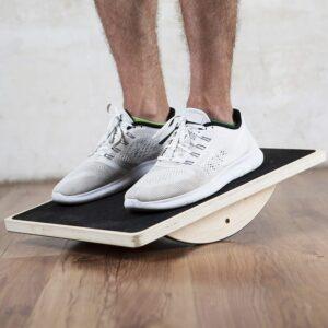 model on wooden balance board
