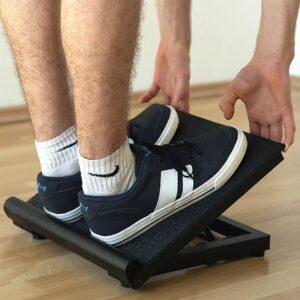 model on slant board stretching